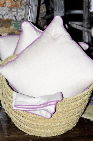 White cushions in a basket for sale