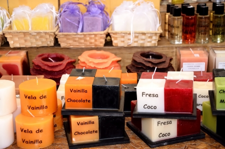 Several candles and sizes for sale at a market