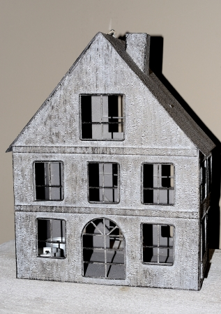 Model of a house made of gray metal