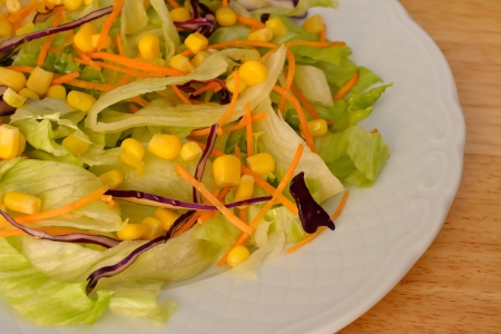 Corn salad with white plate and focus on the center