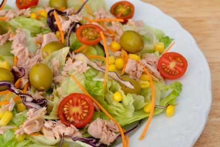 Mixed salad with olives and cherry tomato and tuna photo