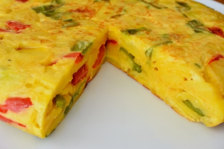 Omelette red pepper and green onion on white plate for dinner
