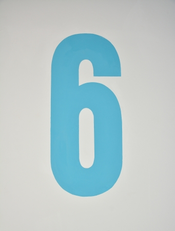 assigning: Number six painted in blue on a wall