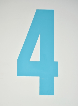 assigning: Number four painted in blue on a wall Stock Photo