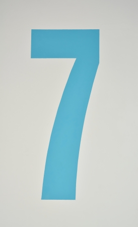 assigning: Number seven painted in blue on a wall
