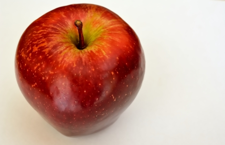 A whole apple red with white background