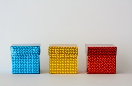 Three boxes of colors, blue, yellow, red with white background