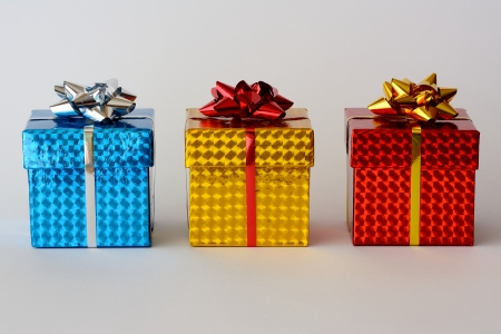 Three small boxes decorated for Christmas gifts