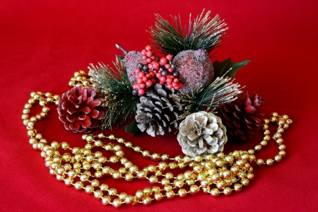 Christmas ornament decorated with objects and pearl necklace gold and red background