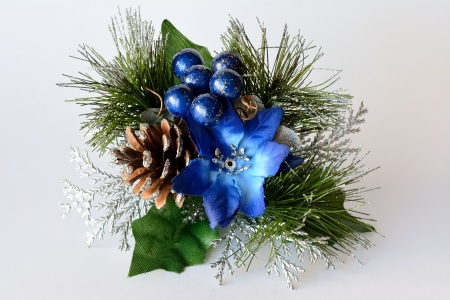Christmas ornament decorated with objects blue and white background
