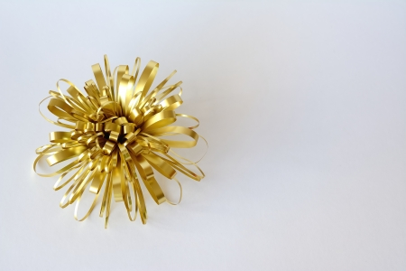 Christmas ornaments with golden ribbon and white background