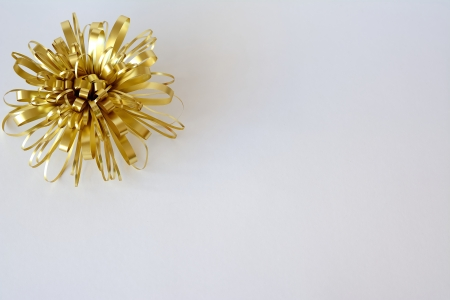 Christmas ornaments with golden ribbon and white background photo