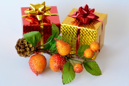 Two gift boxes decorated with Christmas themes