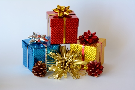 Three brightly colored boxes with christmas decoration