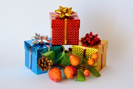 Three gift boxes decorated with Christmas themes