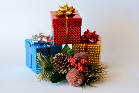 Three brightly colored boxes with Christmas ornaments Stock Photo