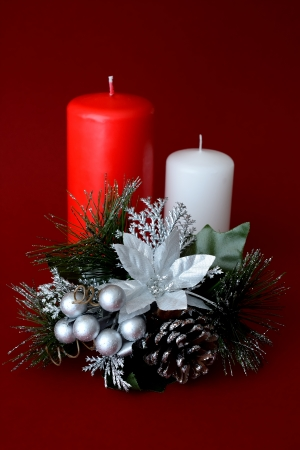 Two candles one red and one white with red background Christmas ornament