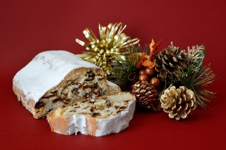 Christmas cake with decorations and red background Stock Photo