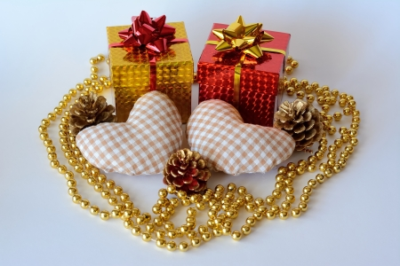 Two gift boxes decorated with two hearts and a pearl necklace and ornaments Stock Photo