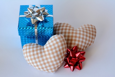 A box with two hearts and ornaments