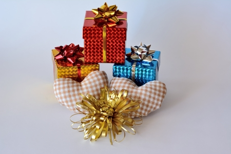 Three gift boxes with two hearts and ornaments