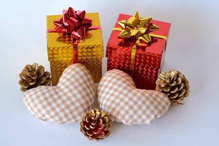 Two gift boxes and two hearts decorated