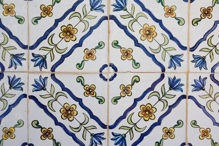 Tile with decorative ornaments in blue and green and yellow flowers