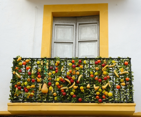 A View of a facade decorated with artificial fruits Stock Photo