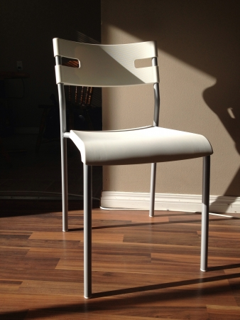 White chair in a natural light ambiance.