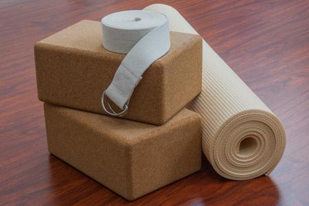Stack of yoga equipment including yoga mat, strap, and cork blocks Reklamní fotografie