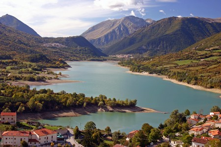 abruzzo: pretty mountain town on a lake in the italian Abruzzo