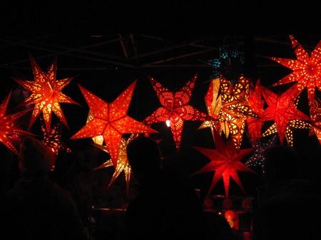 red shiny Cristmas stars illuminated  Christmas stars shine in the night