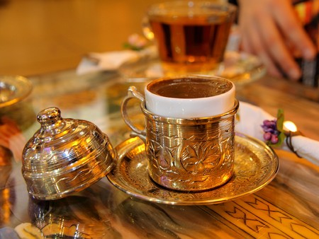 turkish coffee served in a traditional turkish metall dish cap photo