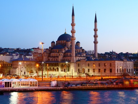 Istanbul with its New Mosque seen from the sea at night with traffic blurs