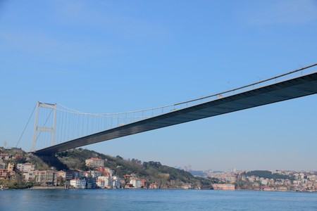 Bosporus suspension bridge  connecting Asia with Europe above the Bosporus  towering over a neighbourhood  near Istanbul, Turkey Stock Photo - 7257960