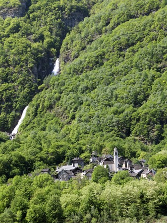 little village built of gray stone stone in the forest at a waterfall in Maggia valley Ticino Stock Photo - 7627935