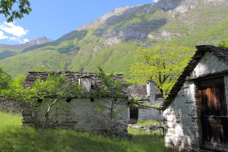 village on a mountain  meadow consisting of old houses put together from rough stone situated in valley of Maggia which is said to be the wildest of all Ticino, Switzerland Stock Photo - 7627940