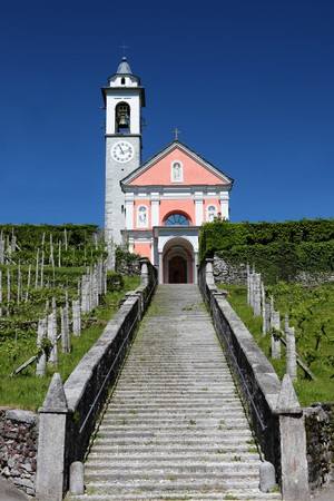 long flight of stairs leading up to a charming bright church on a hill, concept for path to religion, belief, Jesus,  photo
