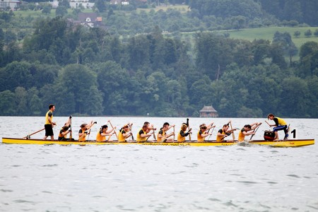 MEILEN - JUNE 12: Athletes fought hard for victory and had fun at the dragen boat racing festival June 12, 2010 in Meilen, Switzerland. Participants were also staff from institutes of EMPA and ETH Stock Photo - 7959781