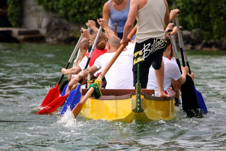 dragonboat: MEILEN - JUNE 12: Athletes fought hard for victory and had fun at the dragen boat racing festival June 12, 2010 in Meilen, Switzerland. Participants were also staff from institutes of EMPA and ETH
