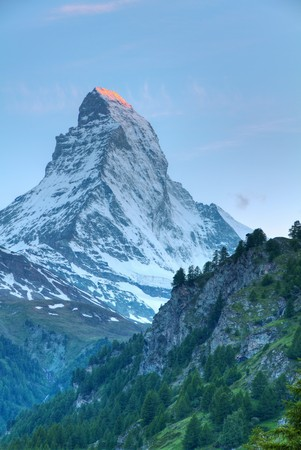famous swiss iconic mountain Matterhorn at sunset with its top still blazing read photo