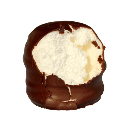 chocolate foam kiss aka chocolate covered marshmallow isolated on white half eaten showing its soft cream filling and chocolate crumble photo