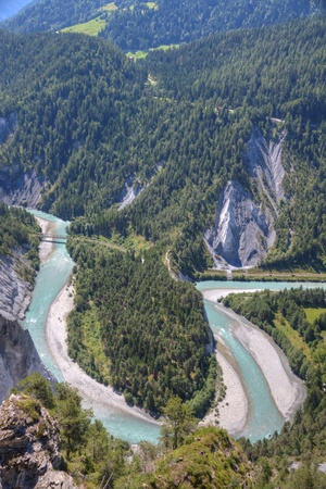 tight river bend filled with light blue water of Rhine Canyon in Switzerland seen from Flims photo