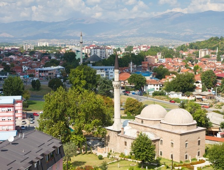 aerial view on the Macadonian capital Skopje with mosques, modern houses and high mountains on the horizon