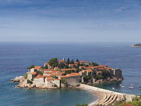 isthmus: Island of Sveti Stefan at the Adriatic coast in montenegro. Its red roofed old houses were used by pirates, now as a hotel resort.