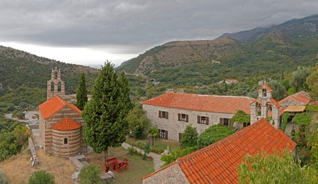 roofed house: group of red roofed buildings forming a little church yard in the mountains of Montegro