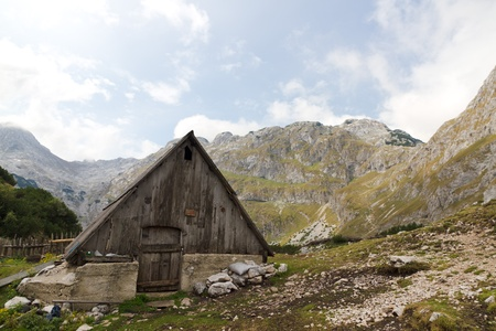 alpine hut: Wooden mountain hut in rough, rocky, backcountry of UNESCO world heritage National Park Durmitor, Montenegro Stock Photo