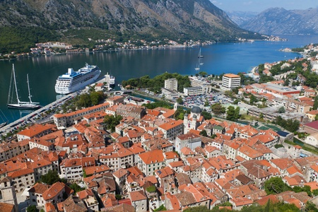 Historic town of Kotor in UNESCO World Heritage Site bay of Kotor with high mountains plunge into adriatic sea, Montenegro