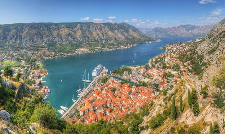 kotor: Panorama UNESCO World Heritage Site bay of Kotor with high mountains plunge into adriatic sea and Historic town of Kotor, Montenegro