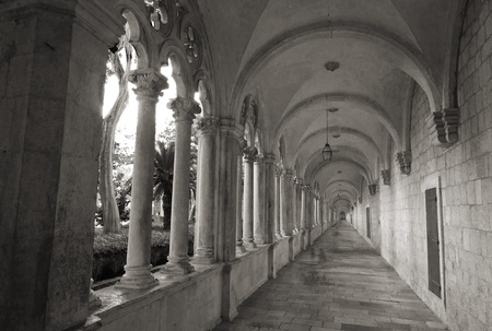franciscan: Converging lines of historic, stone cloister of  franciscan monastery in Dubrovnik, Croatia,black and white